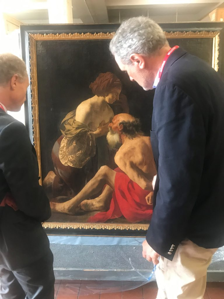 Wayne Franits and a colleague view a resurfaced painting from Hendrick ter Brugghen