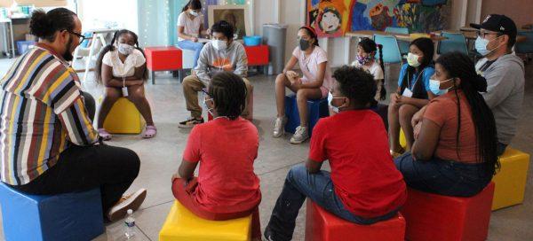 students and alumni reading pwith children at La Casita.