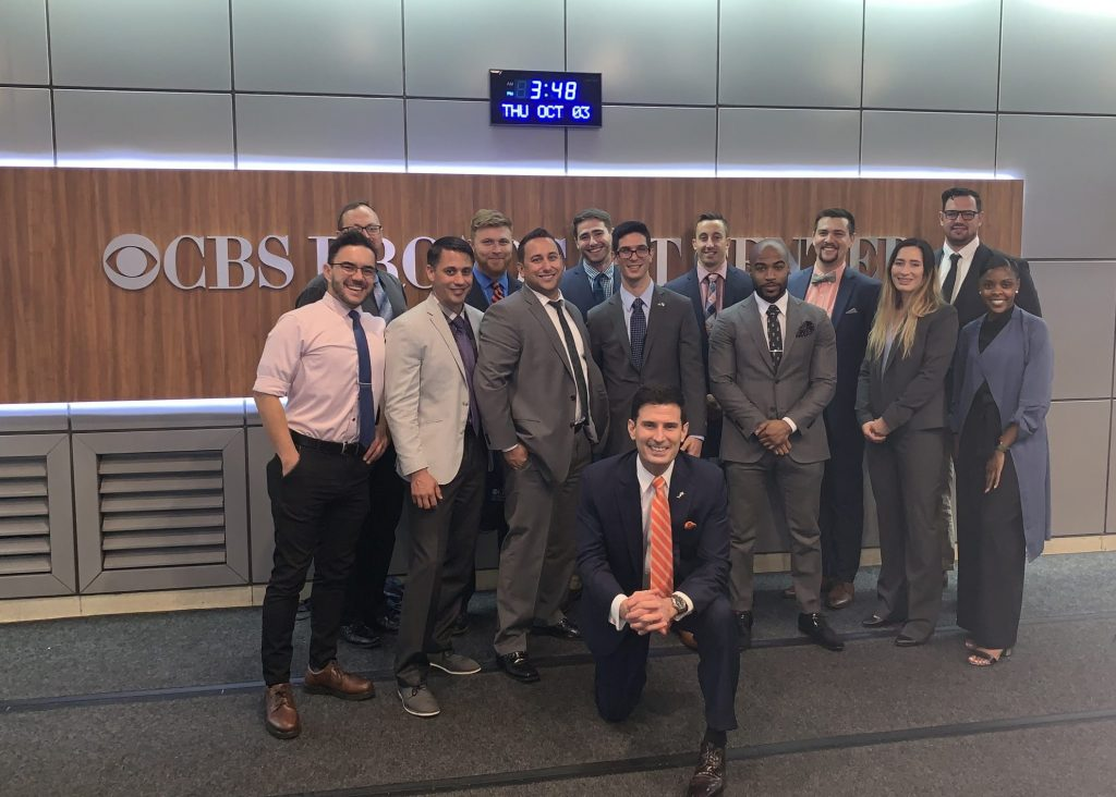 group of people standing in lobby at CBS