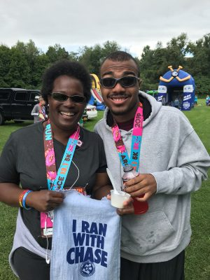 Clarise Shelby-Coleman and her son, Chase, at a 5K run in Syracuse